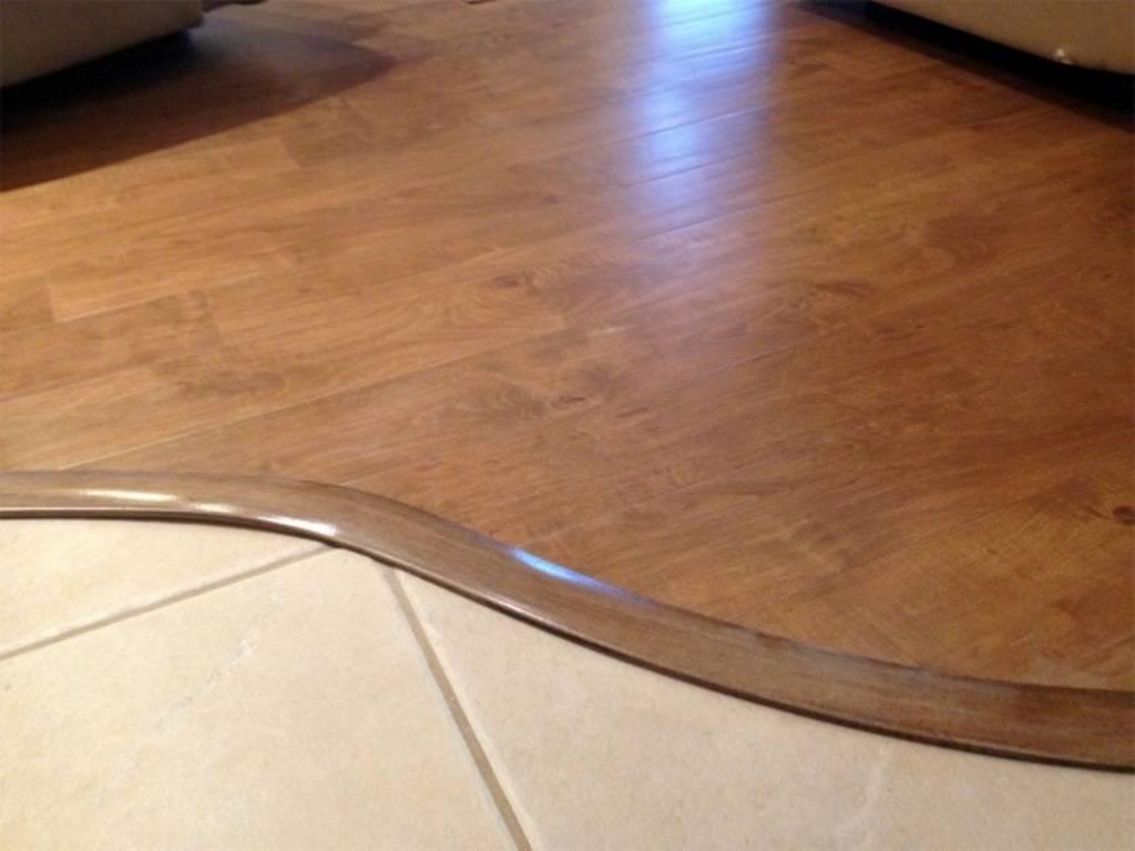 Стык между плиткой и ламинатом: чем закрыть соединение - пробковым профилем или затиркой