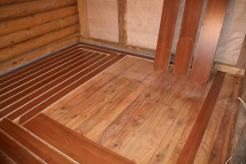 Как сделать тёплый пол на деревянном полу в частном доме — варианты устройства + инструкция