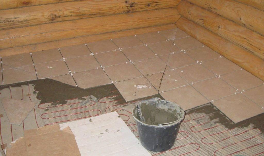 Как сделать теплый пол в бане от печки?