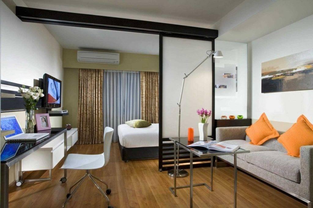 Зонирование комнаты на спальню и гостиную — дизайн и функциональное наполнение