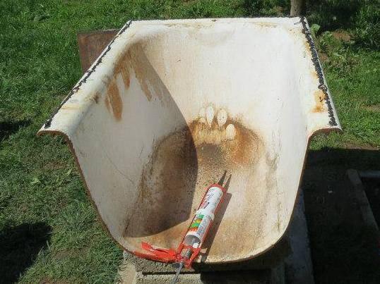 Как делается печь из чугунной ванны своими руками